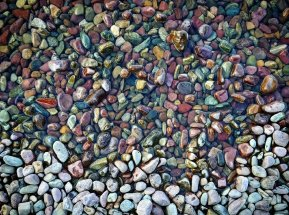 The famous rainbow pebbles at Lake McDonald, Glacier National park