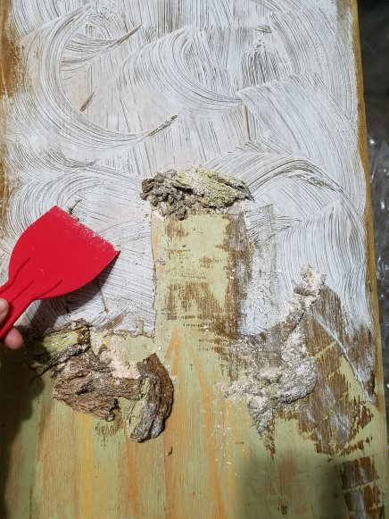 Using Citristrip and a putty knife to remove the old varnish